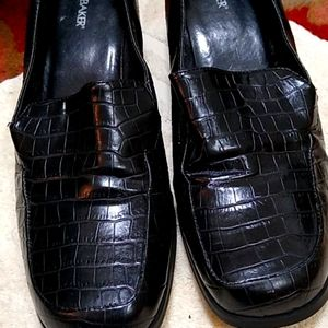 A pair of heel loafers.